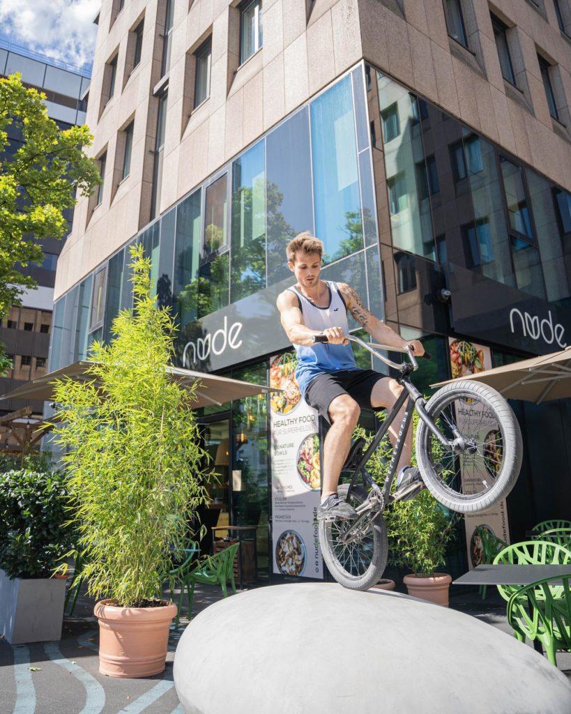 nude food bike delivery sport vegan
